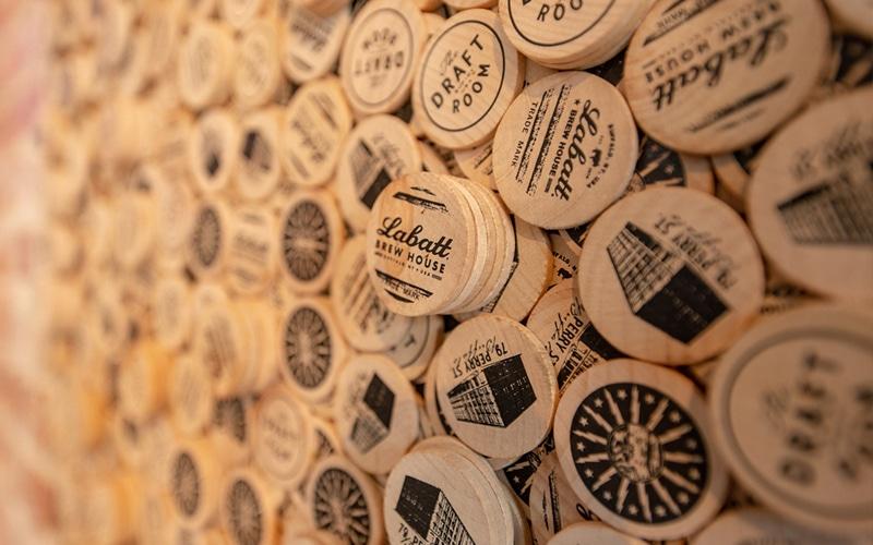 Labatt Brew House wood tokens